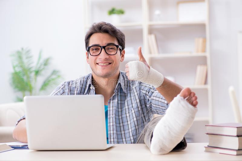 The freelancer with foot injury working from home royalty free stock photos