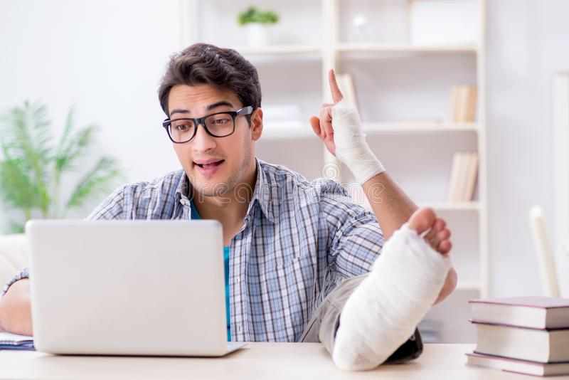 The freelancer with foot injury working from home stock images
