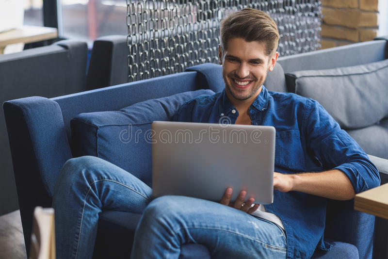 Freelancer happy about successful business deal stock photography