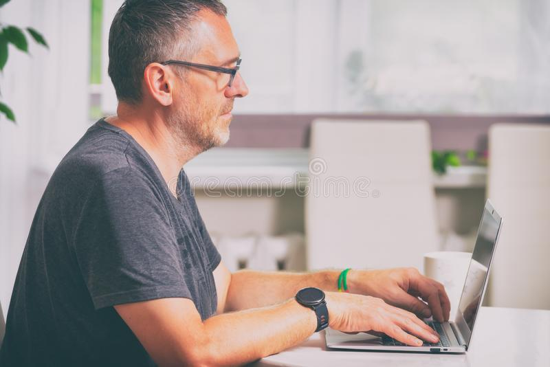 Freelancer man at home stock photography