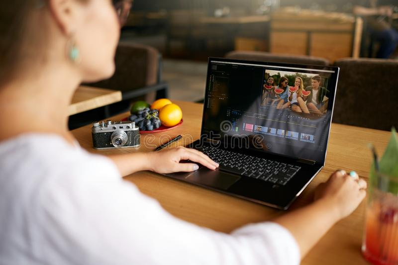 Freelancer video editor works at the laptop computer with movie editing software. Videographer vlogger or blogger camera stock images