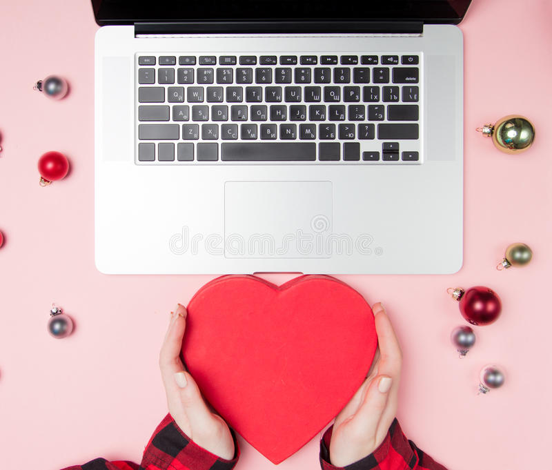 Freelancer woman hands holding Heart Shape Box stock photo