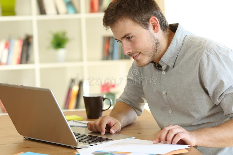 Freelancer working checking on line content at home stock photos