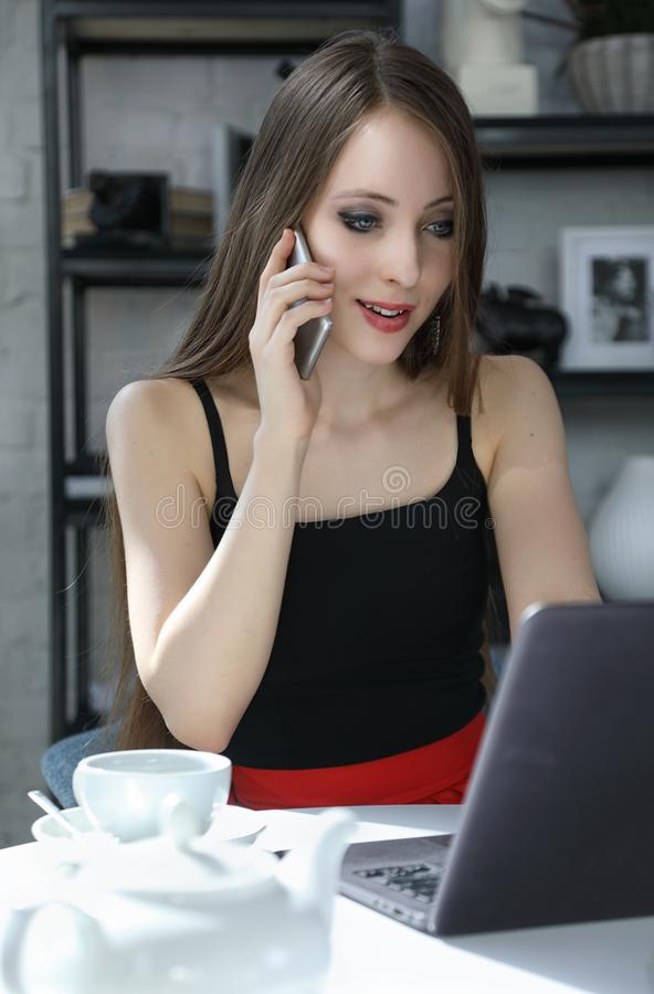Freelancer working in coffee shop stock photo
