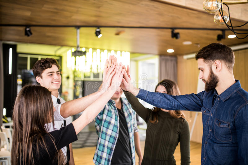 Freelancers people high fiving each other while get the goal of teamwork at start up royalty free stock image