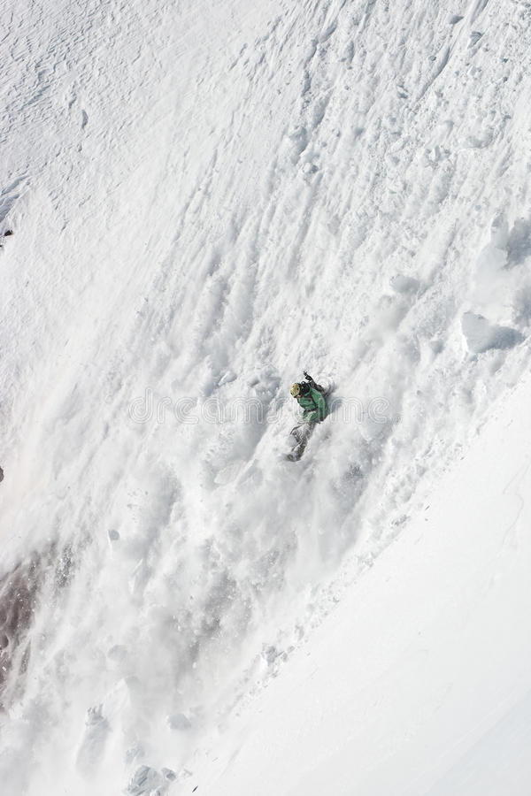 Freerider in a avalanche stock images