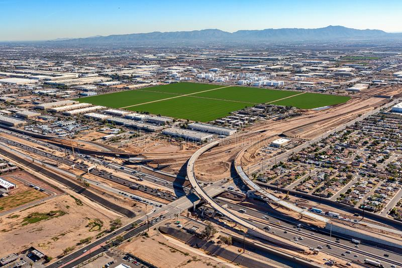 Freeway Interchange Construction in Phoenix, Arizona. Aerial view of construction for a new interchange at Interstate 10 and the Loop 202 freeway in Phoenix royalty free stock photo