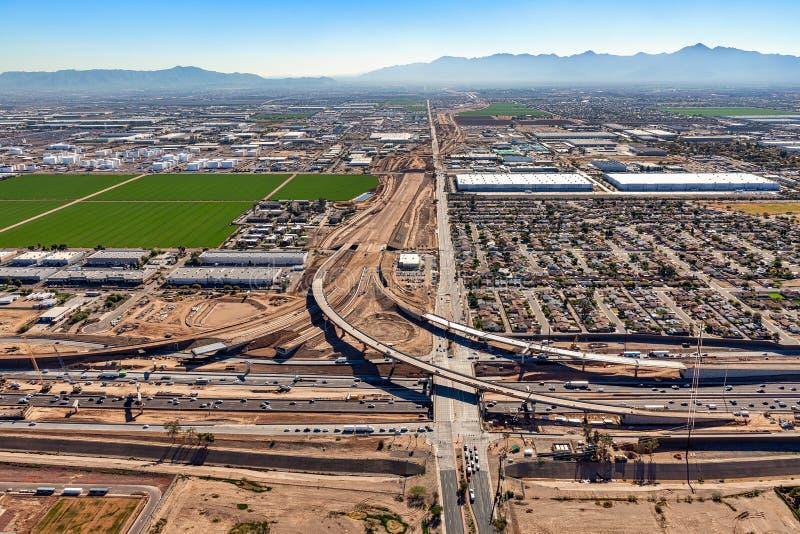 Freeway Interchange Construction. Construction of freeway and Interchange at Interstate 10 and 51st Avenue in Phoenix, Arizona from above stock image
