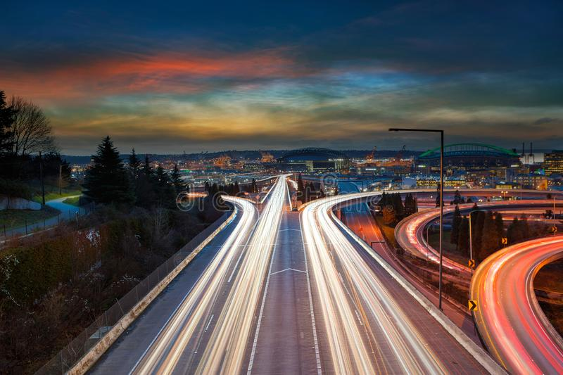 Freeway long exposure Light Trails in Seattle WA at Sunset. Freeway long exposure traffic light trails during sunset in Seattle Washington nUSA royalty free stock photography
