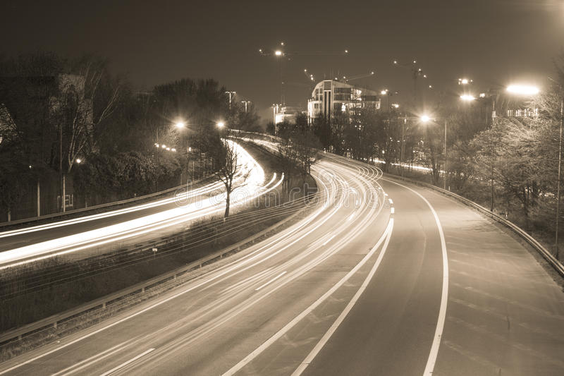 Freeway at night. The freeway B7 next to the city Dusseldorf heading south. At night, in long-time exposure royalty free stock image