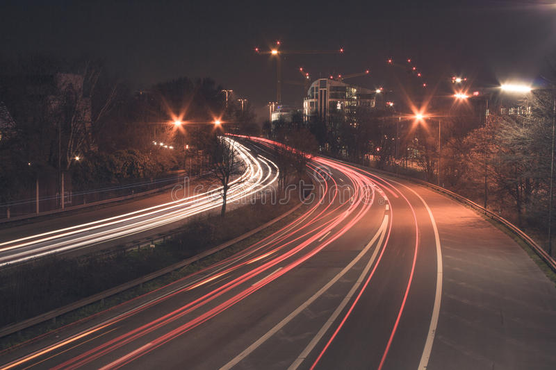 Freeway at night. The freeway B7 next to the city Dusseldorf heading south. At night, in long-time exposure stock images