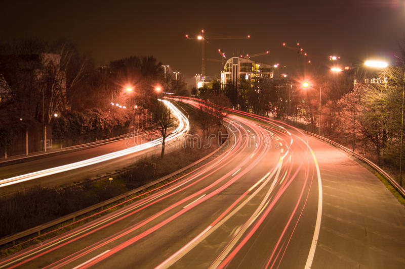 Freeway at night. The freeway B7 next to the city Dusseldorf heading south. At night, in long-time exposure stock image