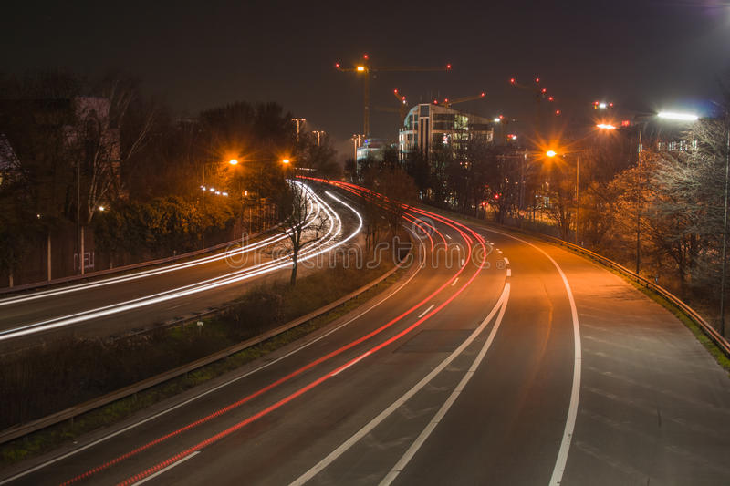 Freeway at night. The freeway B7 next to the city Dusseldorf heading south. At night, in long-time exposure royalty free stock images