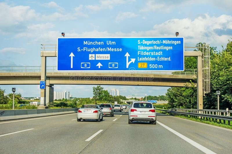 Freeway road sign on Autobahn A8, Stuttgart / Munich / Ulm. Motorway road sign on Autobahn A 8 direction Munich, Ulm - Airport / Messe, exit S Degerloch royalty free stock photos