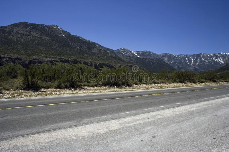 Download Freeway With The Rocks On Horizon Stock Photo - Image of direction, empty: 9705602