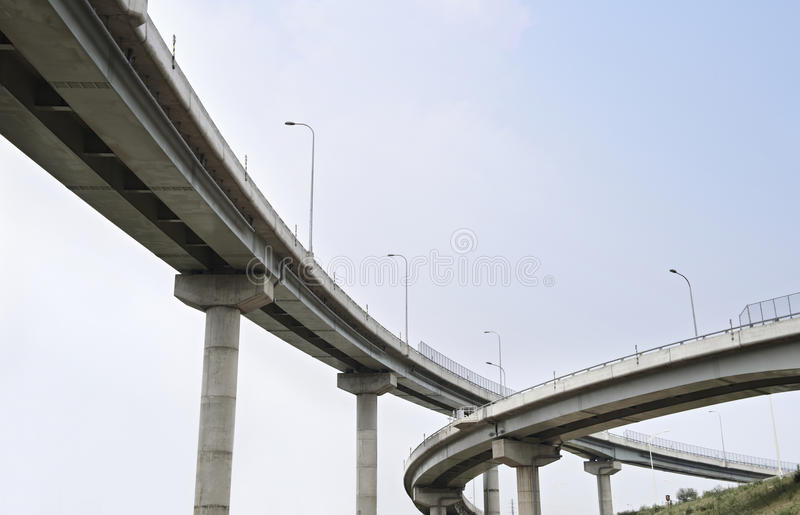 Freeway Span. Overpass on background of blue sky royalty free stock image