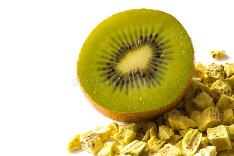 Freeze dried anf fresh kiwi on a white background. Freeze dried and fresh kiwi on a white background. Lyophilization. Food for astronauts royalty free stock images