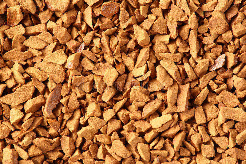 Freeze dried coffee. Close up golden color freeze dried coffee stock photography