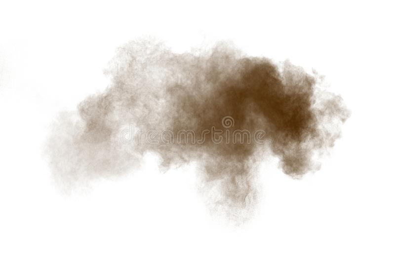 Freeze motion of brown dust explosion.Stopping the movement of brown powder. Explosive brown powder on white background.  royalty free stock image
