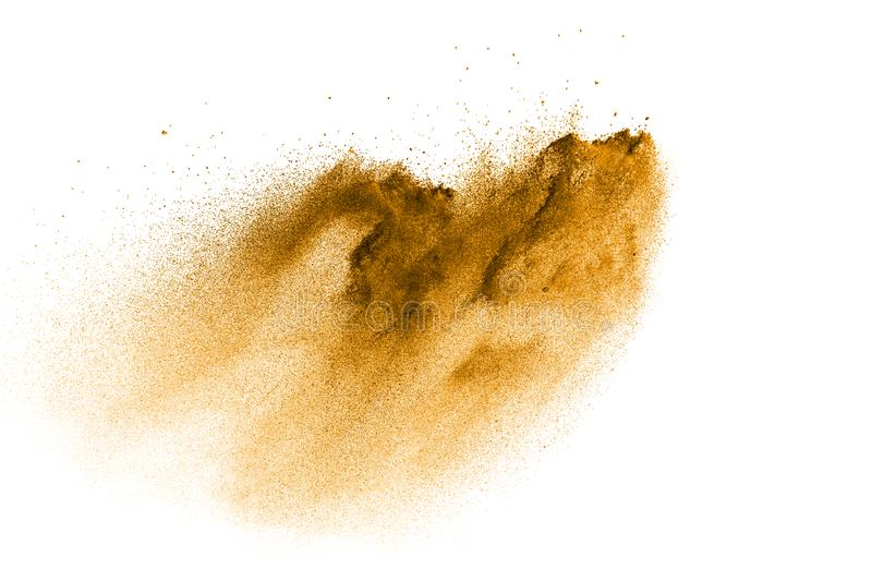 Freeze motion of brown dust explosion. Stopping the movement of brown powder. Explosive brown powder on white background. Dry soil splatter on white background stock photos