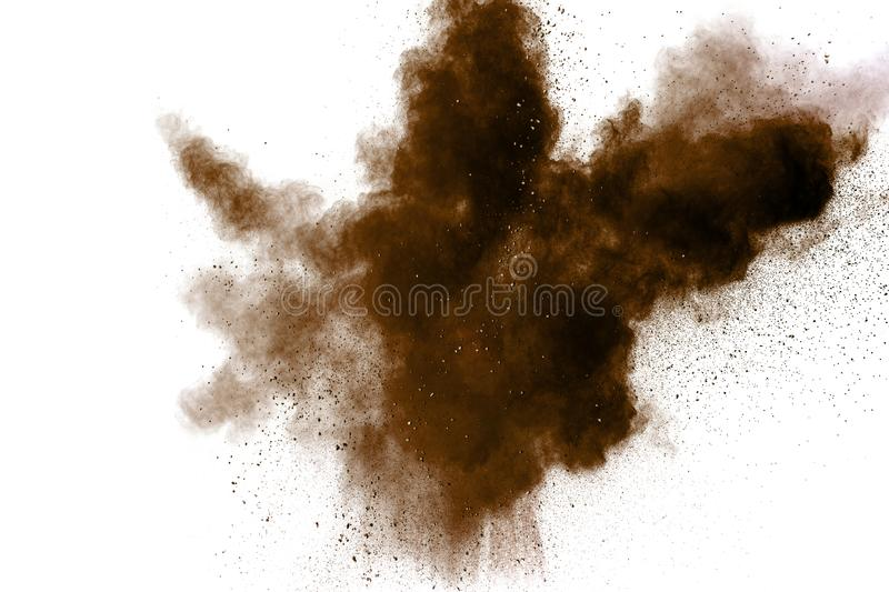 Freeze motion of brown dust explosion. Stopping the movement of brown powder. Explosive brown powder on white background. Dry soil splater on white background royalty free stock photos