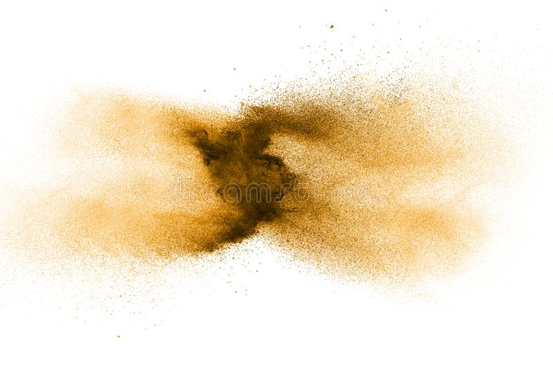 Freeze motion of brown dust explosion. Stopping the movement of brown powder. Explosive brown powder on white background. Dry soil splatter on white background stock images