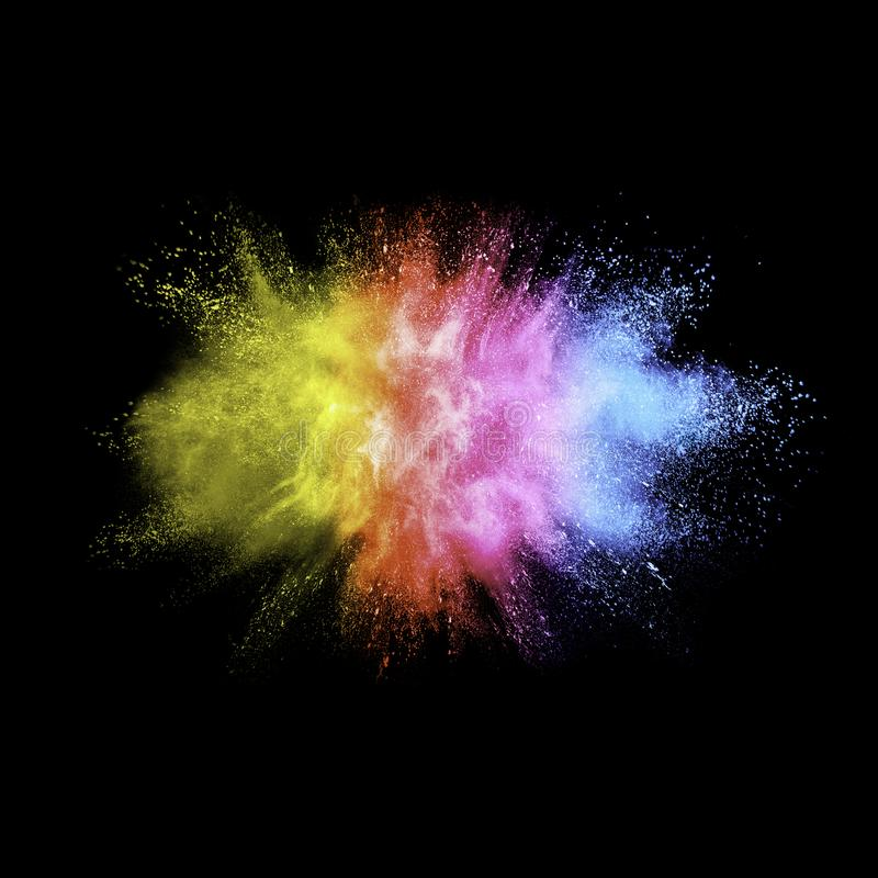 Freeze motion of color dust particles splash. Multicolored powder explosion cloud isolated on black background. Freeze motion of color dust particles splash royalty free stock photo