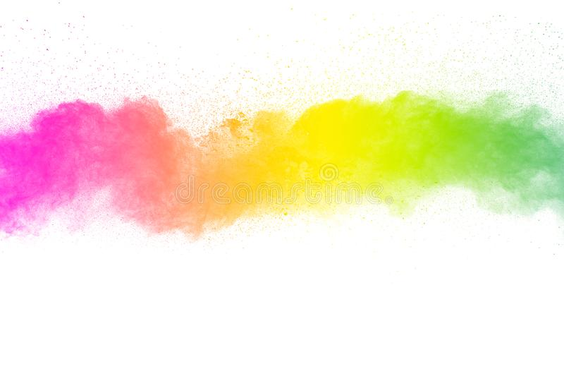 Freeze motion of color particles on white background. Multicolored granule of powder explosion stock image