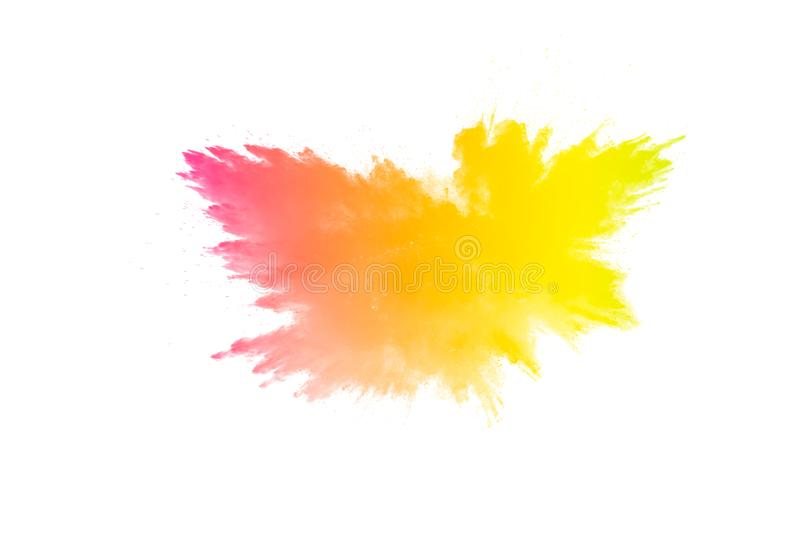 Freeze motion of color particles on white background. Multicolored granule of powder explosion stock photo