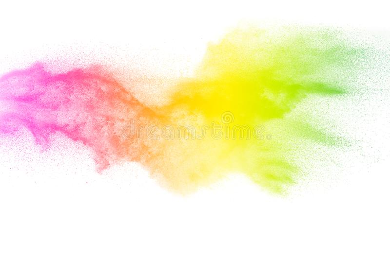 Freeze motion of color particles on white background. Multicolored granule of powder explosion. Abstract color dust overlay texture stock photography