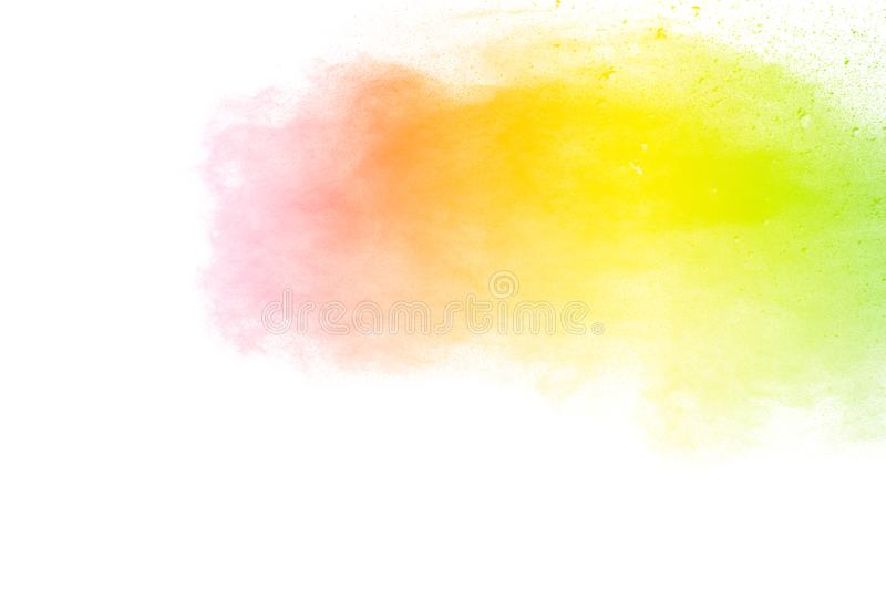 Freeze motion of color particles on white background. Multicolored granule of powder explosion. Abstract color dust overlay texture stock photo