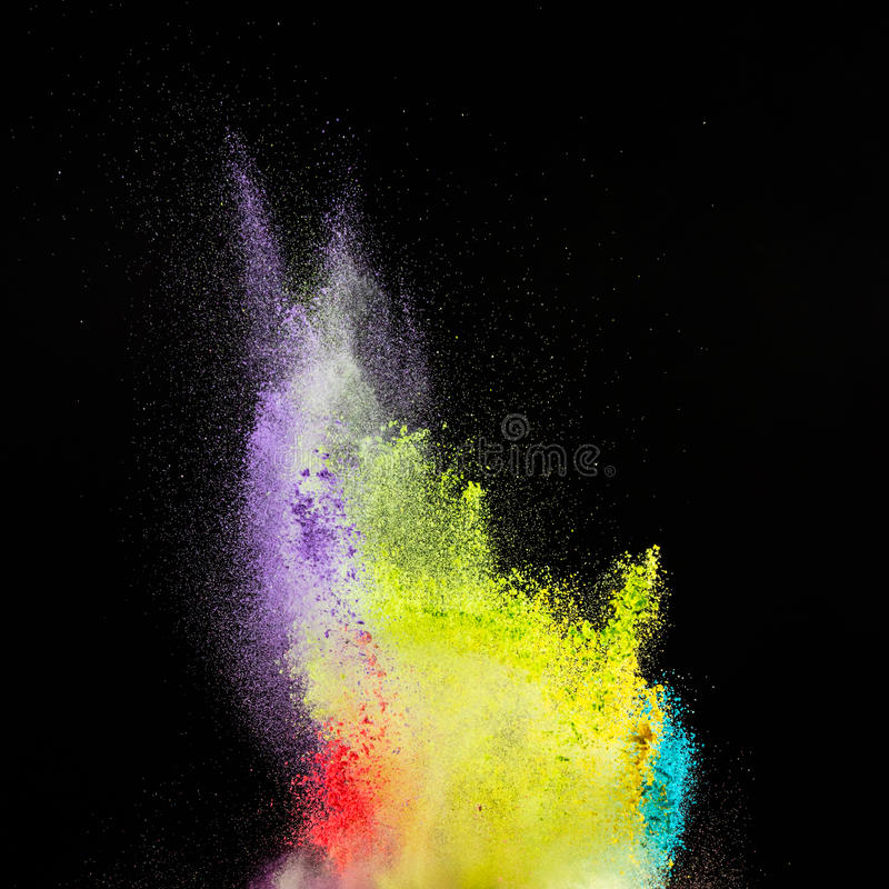 Freeze motion of colored dust explosion. royalty free stock photography
