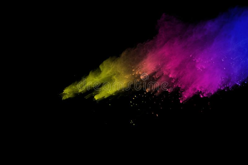 Freeze motion of colored powder explosion isolated on black background. Abstract of Multicolor dust splatted. Freeze motion of colored powder explosion isolated royalty free stock photography