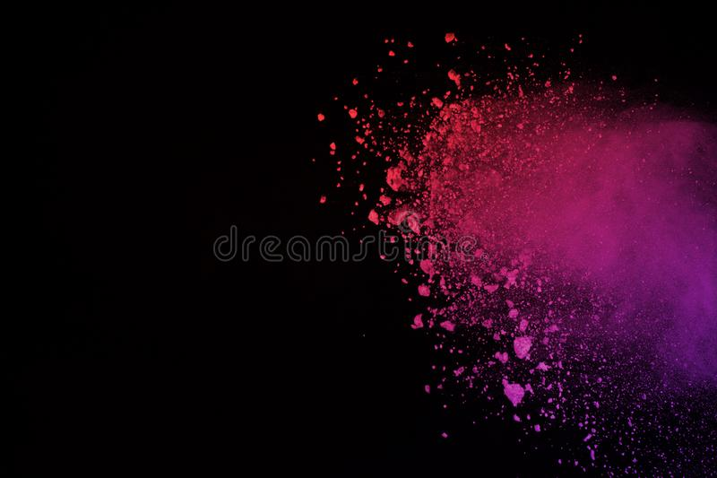 Freeze motion of colored powder explosion isolated on black background. Abstract of Multicolor dust splatted. royalty free illustration