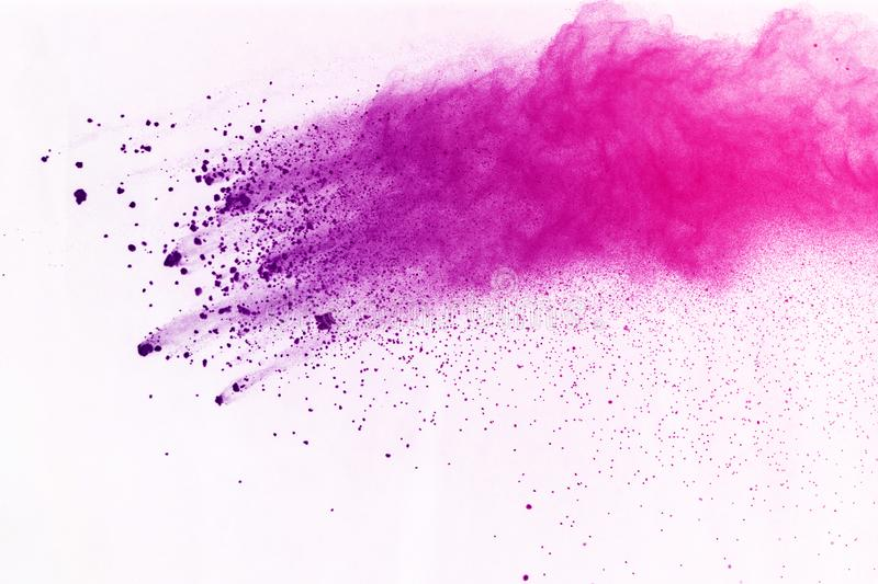 Freeze motion of colored powder explosion isolated on black background. Abstract of Multicolor dust splatted. stock image