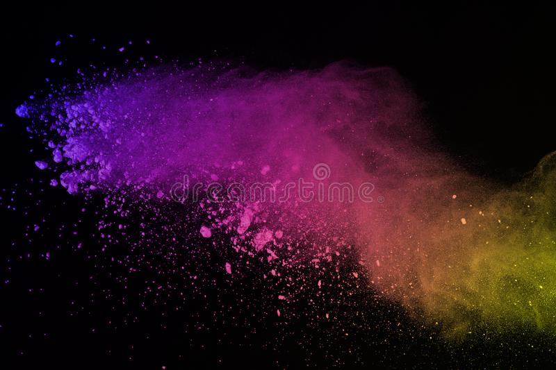 Freeze motion of colored powder explosion isolated on black background. Abstract of Multicolor dust splatted. stock illustration
