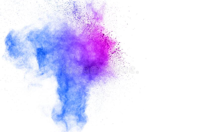 Freeze motion of colored powder explosions isolated on white background.Color dust particle splattered on background.  stock images