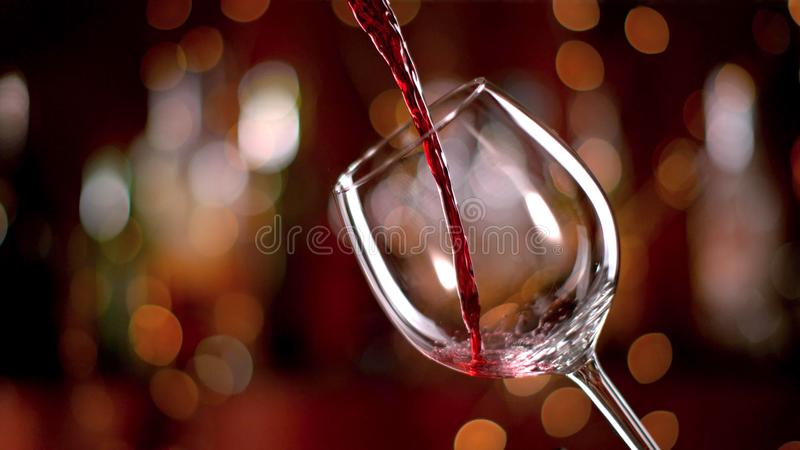 Freeze motion of pouring red wine into goblet royalty free stock photo