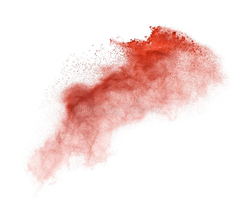Freeze motion of red dust explosion isolated on white background royalty free stock image
