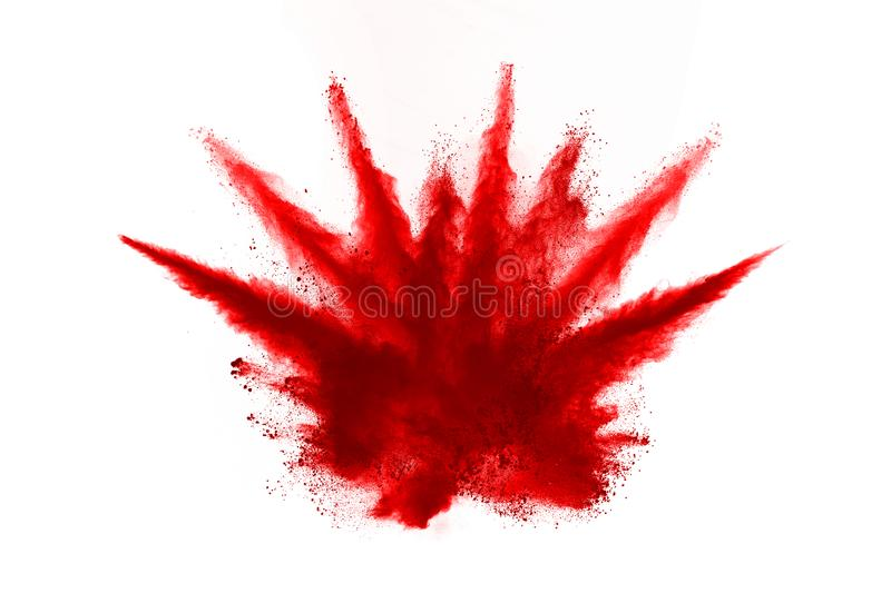 Freeze motion of red powder exploding, isolated on white background. Abstract design of red dust cloud. stock photography