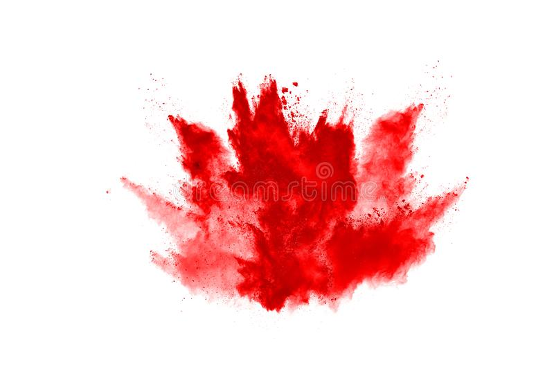 Freeze motion of red powder exploding, isolated on white background. Abstract design of red dust cloud. Particles explosion screen saver, wallpaper royalty free stock images
