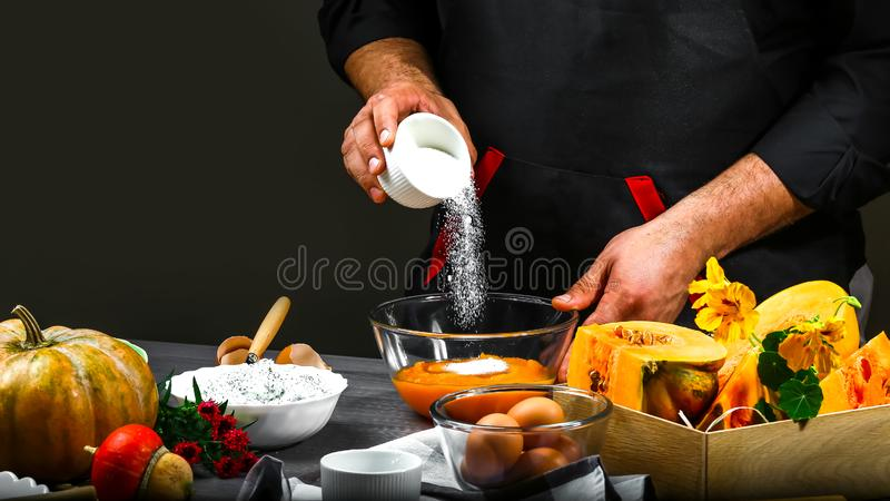 Freezer food prepare in process of a chef hands preparing an American pumpkin pie. The concept of American cooking recipe.  stock photography