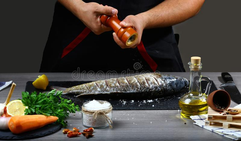 Freezer food prepare in process. cooking process to pepper fish carp, lemon, herbs and spices on a shale board. Top view, place fo. R text stock photos