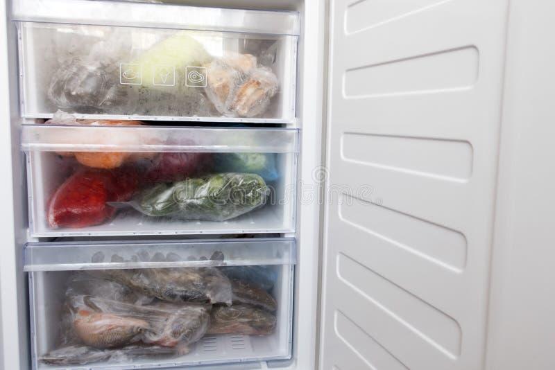 Freezer refrigerator. With various frozen foods stock images