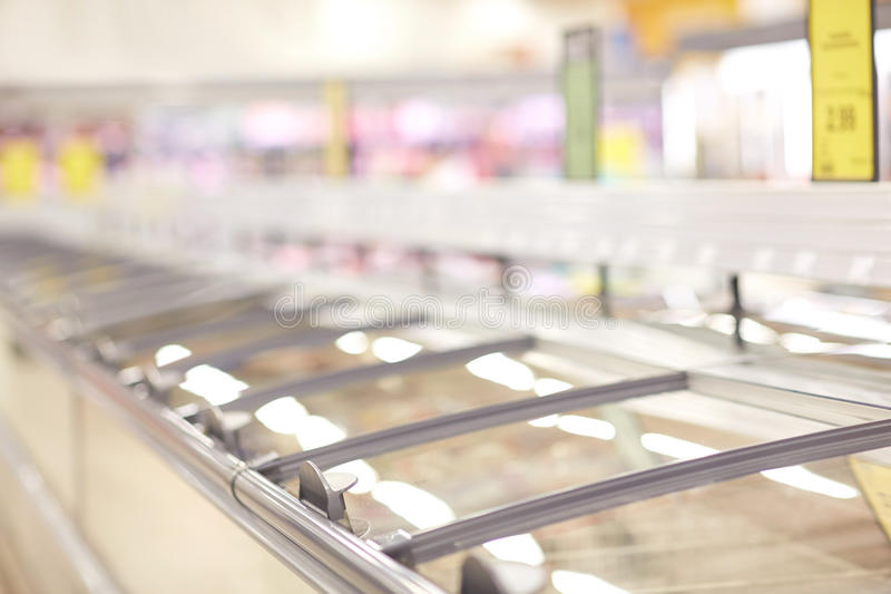 Freezers at grocery store. Sale, shopping, consumerism and storage concept - freezers at grocery store stock photos