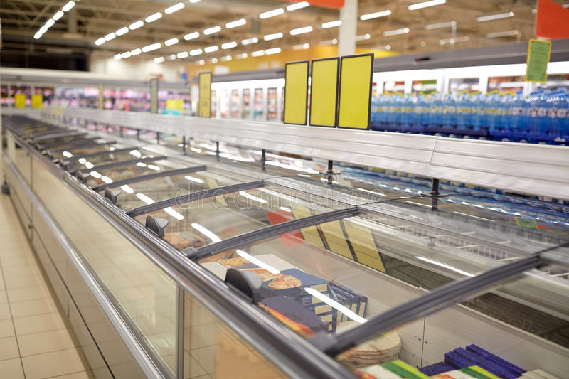 Freezers at grocery store. Sale, shopping, consumerism and storage concept - freezers at grocery store stock photography