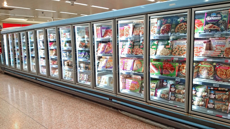 Freezers. A row of supermarket freezers, in a well known outlet selling all sorts of frozen food types royalty free stock photos