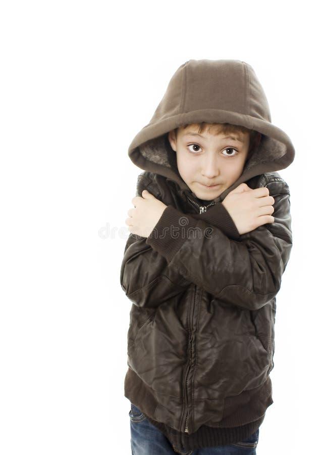 Freezing boy. Isolated on white background royalty free stock photography