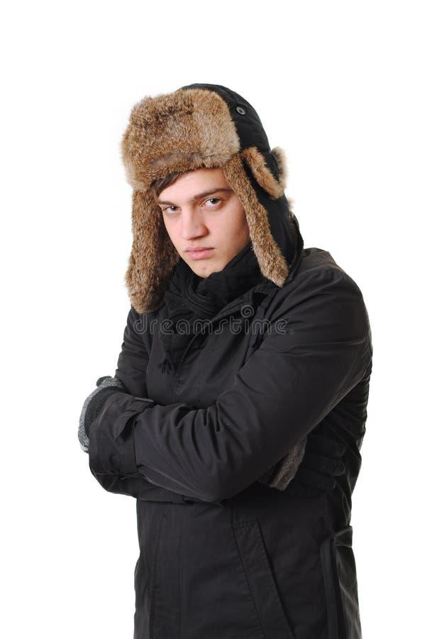 Freezing man with winter clothing stock image