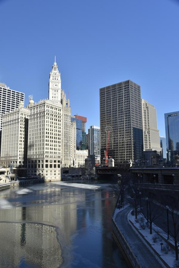 A Freezing River. This is a Winter picture of the Chicago River in early stages of freezing over. In the background are some of the iconic building on the banks royalty free stock image